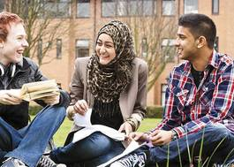 Institution featured at 70 percent quality 886 students relax on campus lawn uni salford20120906 2 1stjlcz